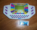Buy Electronic Games  - ELECTRONIC WHEEL OF FORTUNE HANDHELD GAME W/CARTRIDGE 9