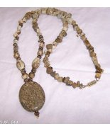 Solid jasper pendant with tan shards, oblong be... - $20.00