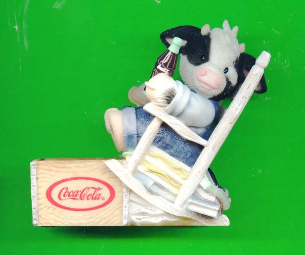 Moo BOY in Rocker Drinking Coke