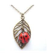 Antiqued Brass Leaf Porcelain Ladybug Necklace - $14.99