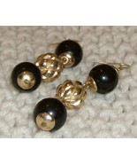 black onyx and gold beads in a 3