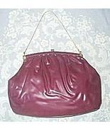 Purple_vinyl_handbag_one_thumbtall
