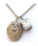 Antiqued Brass Cross Porcelain Owl Locket Neckl... - $13.99