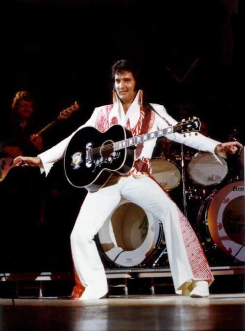 Elvis Presley On Stage Wearing His Red Phoenix Jumpsuit
