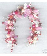 Loaded Fringe Charm Bracelet Pinks Reds Whites ... - $59.99