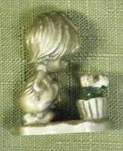 Hallmark 1975 Little Girl Looking at Flowers - $6.80
