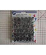 Wilton alphabet and numbers fondant gumpaste cu... - $19.99