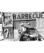 Black Man Sits On Bench At Barbecue Hut 8x12 Re... - $23.30