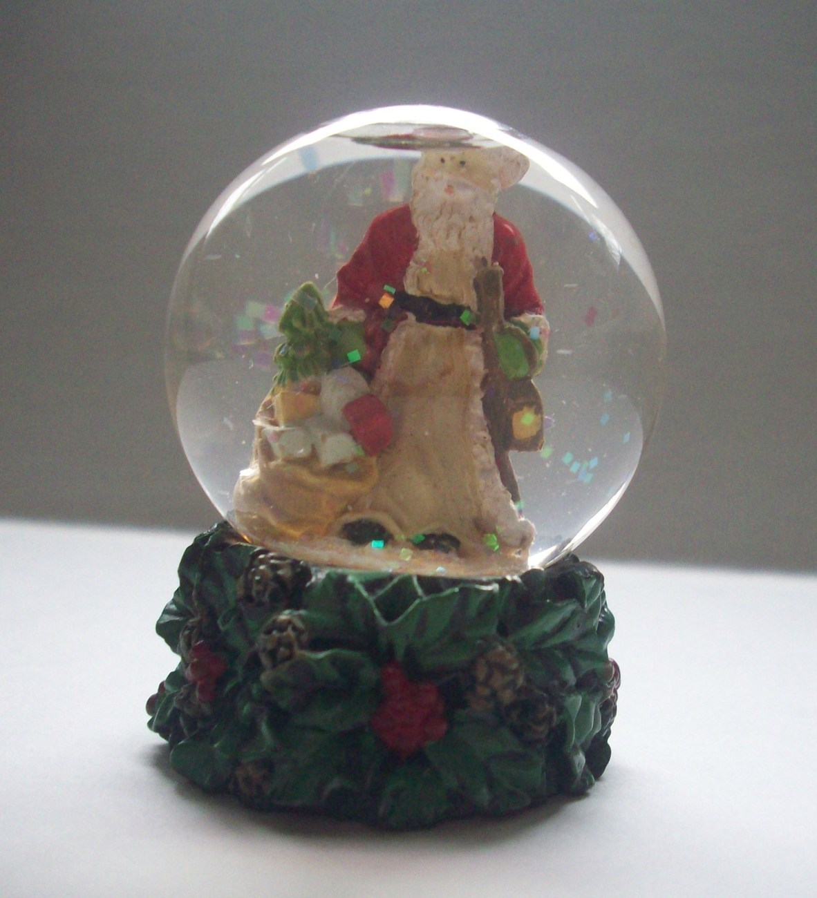 Snow Globe Miniature Santa Theme Holly and Pine 2.5 Inch Resin and Glass