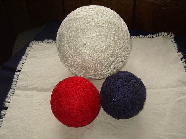 Red White and Blue Balls of String