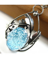 Jungle in the Sky Necklace - Carved Blue Topaz ... - $760.00