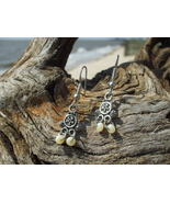 Bali design mother of pearl glass bead earrings  - $8.99