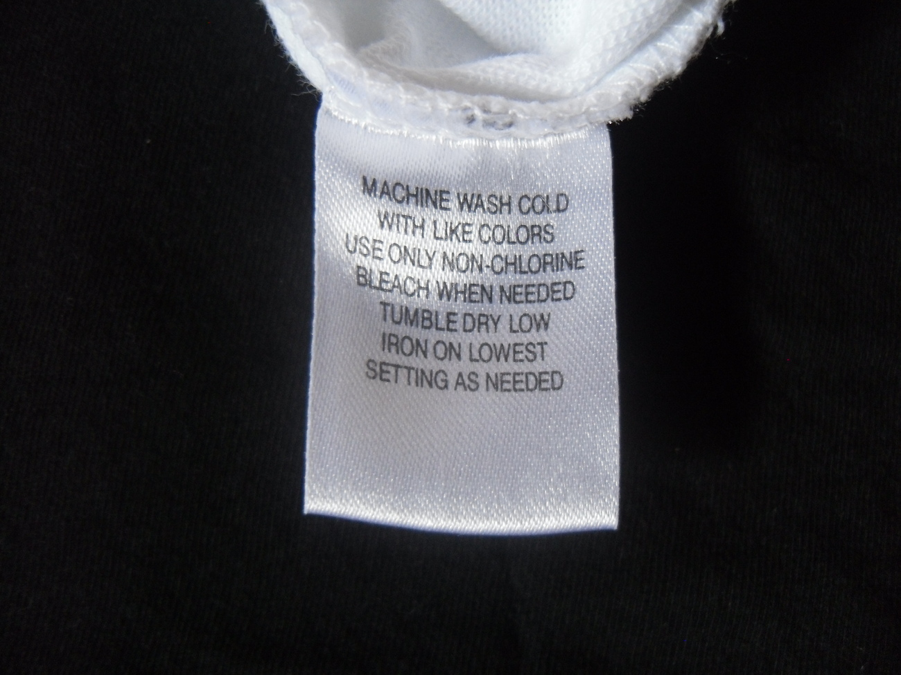 White_crossover_top_care_label