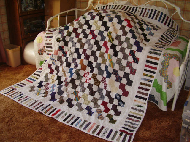 Bowtie pattern quilt, made of men's ties + machine pieced & quilted