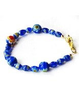 Blue round and oblong Millifiori glass beaded b... - $6.00