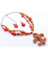 Chunky fleur de lis pendant orange natural ston... - $15.84