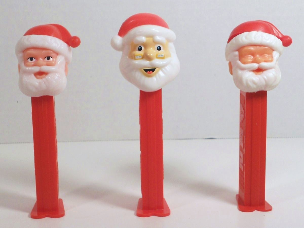 PEZ Santa various Santa C open eyes, 3.9 closed eyes thin feet, & a D glasses