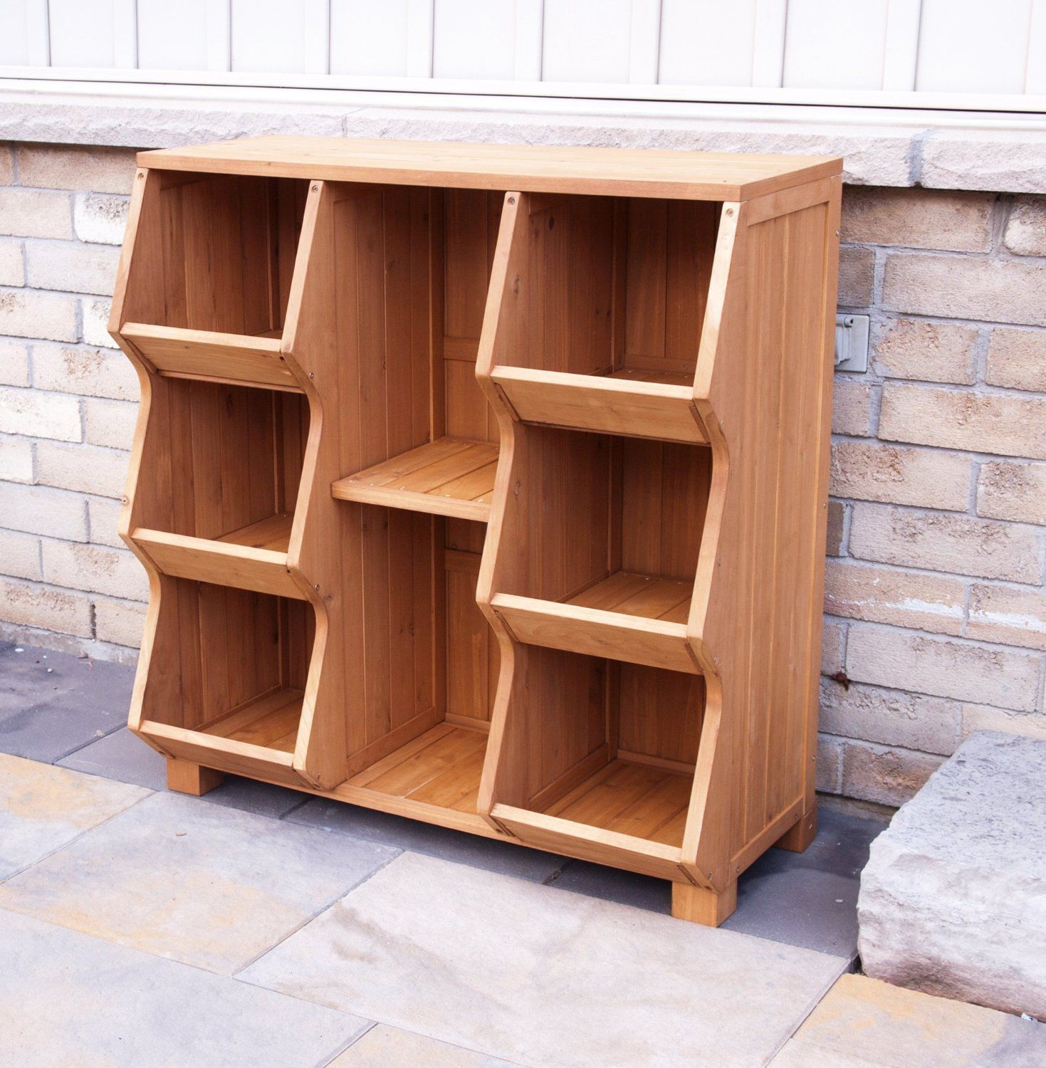 Storage cabinet/book case includes 6 storage bins and a top shelf for extra display/storage space. Use in Kid's room play area family room entryway or anywhere additional storage is .