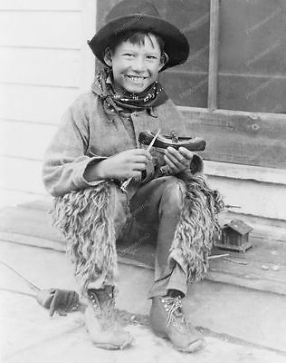"Young Little ""Cowboy"" Carves Canoe 8x10 Reprint Of Old Photo"