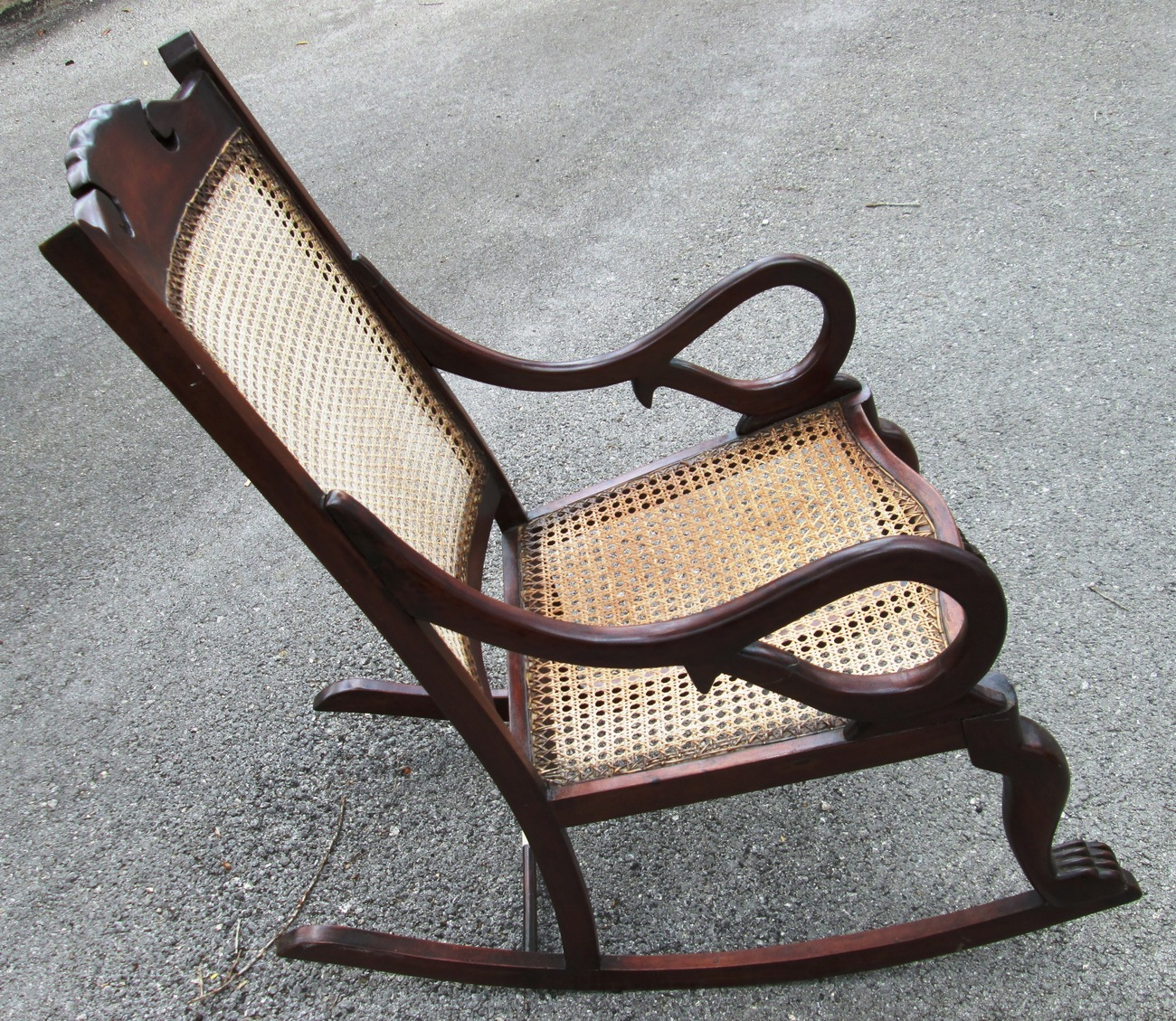 Antique barbados mahogany rocking chair with caned bottom