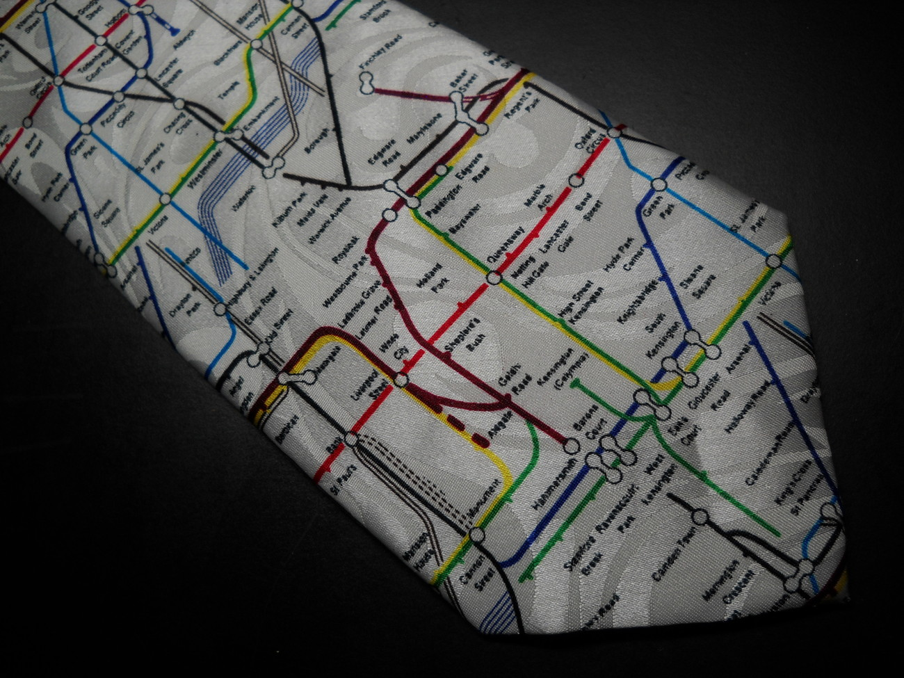 Gold City Neck Tie London Tube System in Bright Colors On Background of Whites Gold City